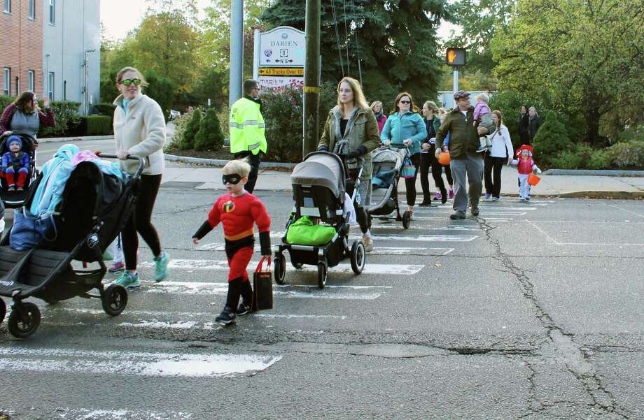 Participants in the Mom's Morning In Halloween Parade began their march at the Mechanic Street parking lot in Darien, CT on Oct. 28, 2016. Photo: Erin Kayata / Hearst Connecticut Media / Darien News