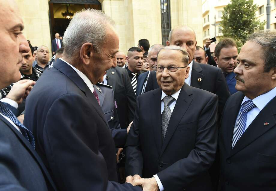 Newly-elected Lebanese President Michel Aoun (center) greets parliament Speaker Nabih Berri. Photo: Hassan Ibrahim, Associated Press