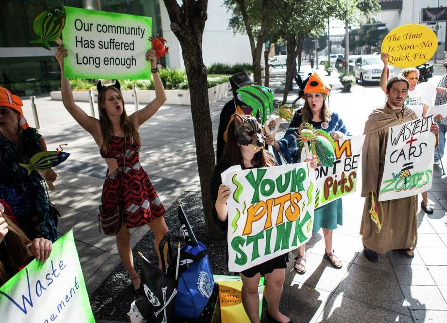 In 2016, protesters from the San Jacinto River Coalition demonstrated outside the Waste Management of Texas headquarters. The demonstrators were calling for a cleanup of the Superfund site. Photo: Brett Coomer, Houston Chronicle / © 2016 Houston Chronicle
