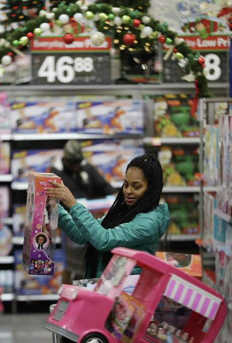 Choisette Hargon of Paterson, N.J., shops for toys ahead of Christmas at a Walmart in Teterboro, N.J. Consumer spending increased 0.5 percent in September, a significant rebound from August when spending fell 0.1 percent, the Commerce Department said Monday. Photo: Julio Cortez /Associated Press / Copyright 2016 The Associated Press. All rights reserved.