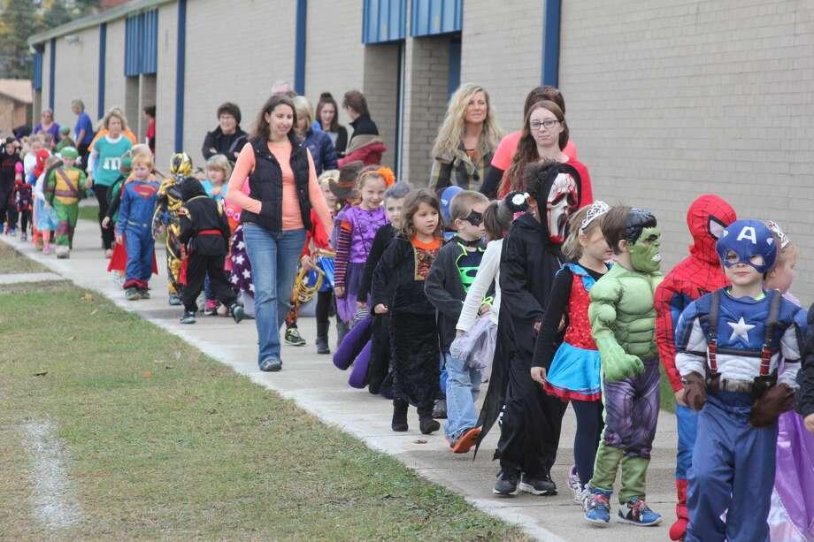 Bad Axe Elementary students hold their annual Halloween parade around campus. Photo: Bradley Massman/Huron Daily Tribune