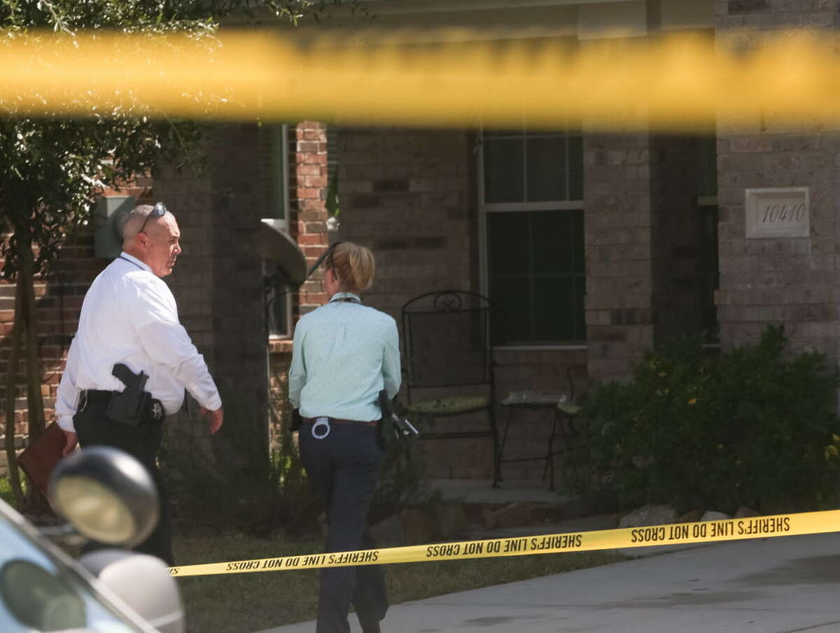 Authorities investigate a homicide in which a woman was killed, at 10410 Fire Sage Dr., Monday, Oct. 31, 2016, in Humble.