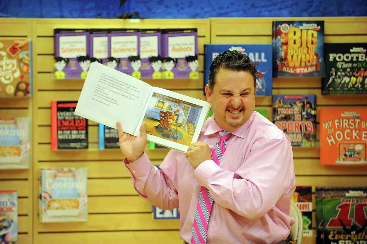 Julia A. Stark School Assistant Principal Joe Claps reads a spooky Halloween story during the Stamford Public Education Foundation's Halloween Book Fair at Barnes & Noble in Stamford, Conn. on Sunday, Oct. 30, 2016.