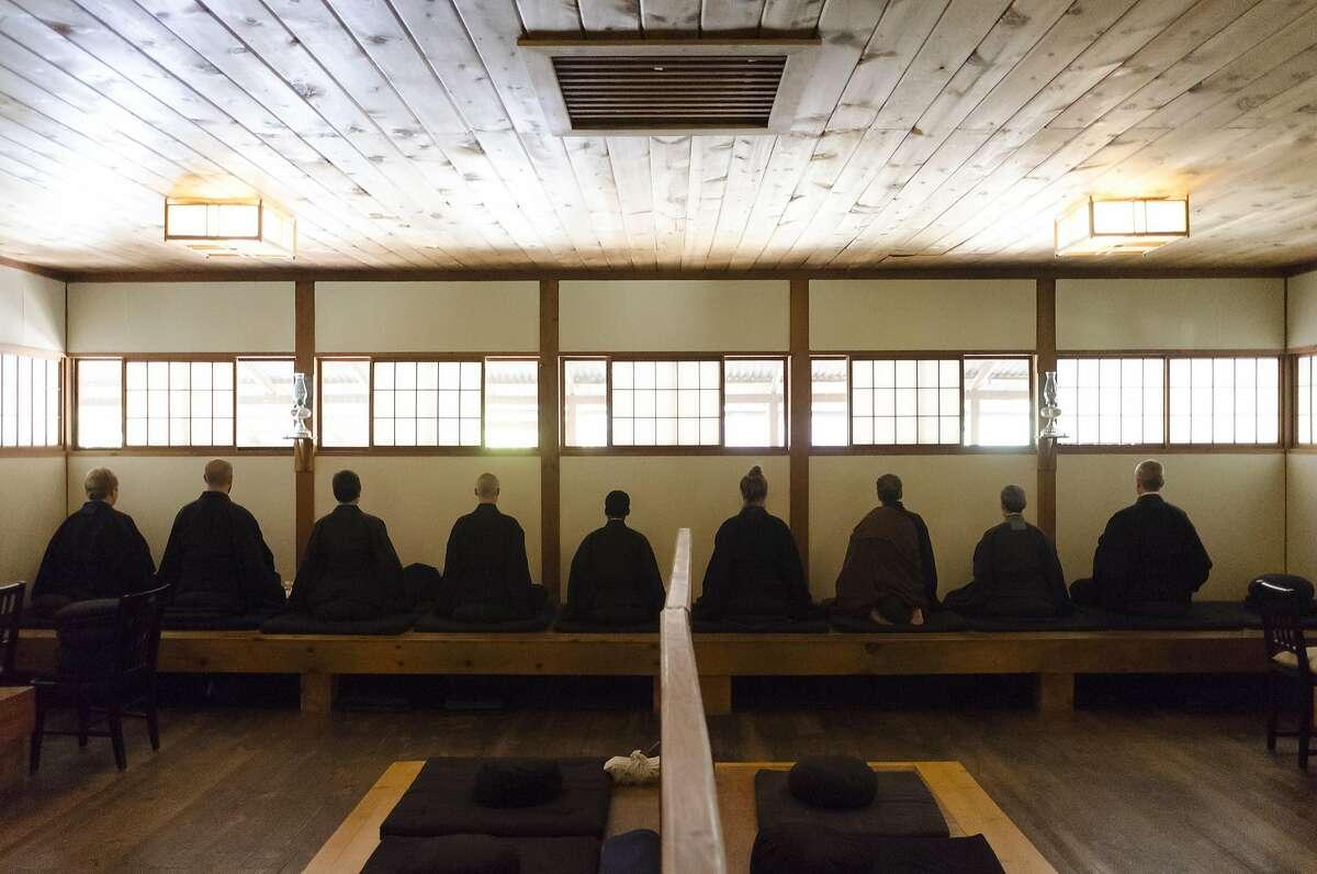 Monks meditate in the Zendo at Tassajara Zen Center in Jamesburg, CA, on Thursday October 20, 2016. Zendo refers to a Japanese mediation hall.