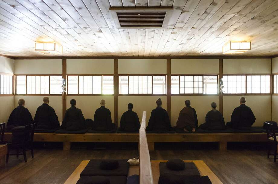 Monks meditate in the Zendo. Photo: Brandon Chew, Special To The Chronicle