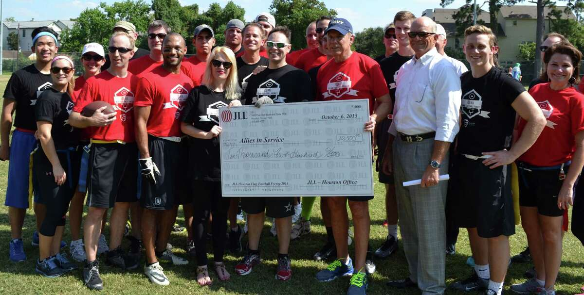 Employees of JLL raised money at a charity flag football game last fall. The commercial real estate firm is a 2016 Top Workplace winner.