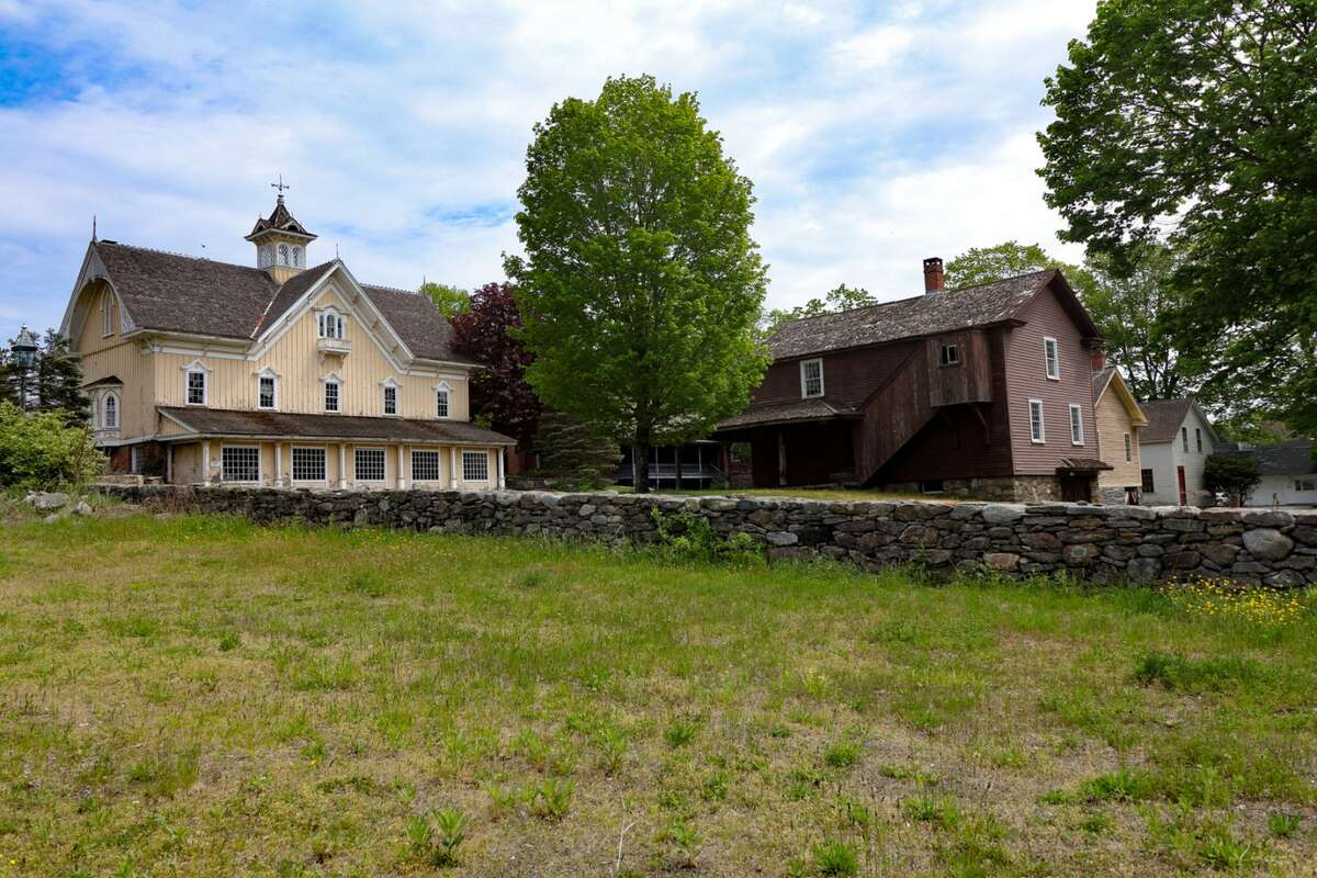 The town of Johnsonville, Conn., established in 1802 near East Haddam, has sold for $1.85 million. The town features a former bank, post office, general store, school, church, restaurant, and several homes.