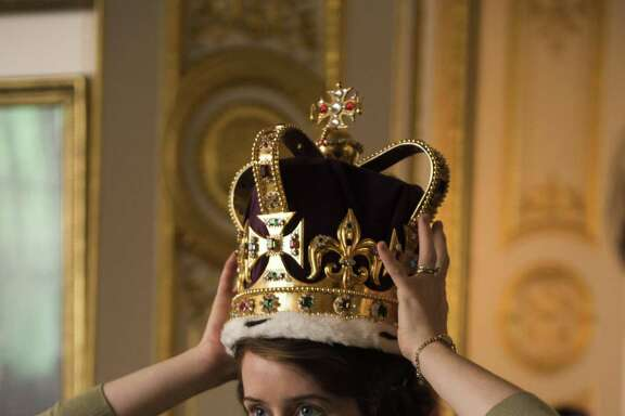 "Elizabeth II (Claire Foy) practices wearing the 5-pound crown in ""The Crown."""