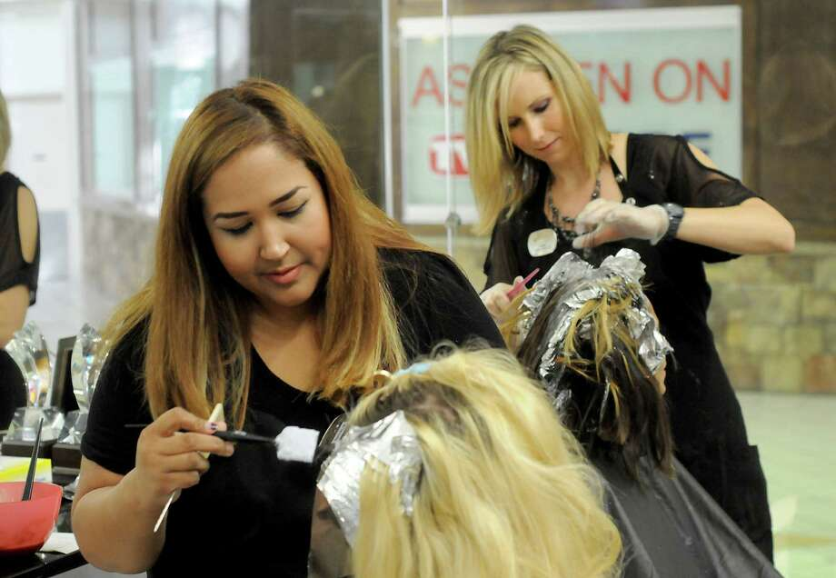 At left, Taylor Davis has her hair done by Natalia Nichols while Jennifer Lippe works on Mary Roman at the Visible Changes at Willowbrook Mall Saturday Sept. 24, 2016. (Dave Rossman Photo) Photo: Dave Rossman, Freelance / Dave Rossman