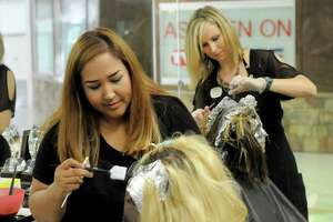 At left, Taylor Davis has her hair done by Natalia Nichols while Jennifer Lippe works on Mary Roman at the Visible Changes at Willowbrook Mall Saturday Sept. 24, 2016. (Dave Rossman Photo)