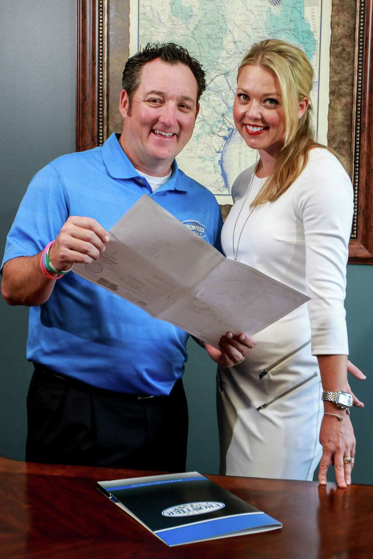 Doug Watson, president of Frontier Title, and Keri Burdette, v.p. of marketing and client relations, reviewing a file. (For the Chronicle/Gary Fountain, October 4, 2016)
