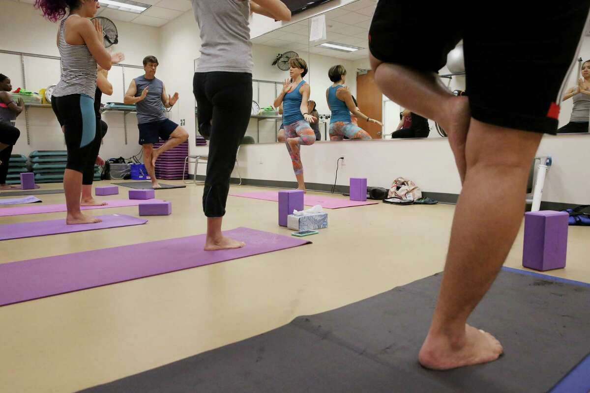Heavy Construction Systems Specialist employees at a yoga during lunch hour Wednesday, Sept. 28, 2016, in Sugar Land. HCSS provides benefit activities, including an outdoor track and basketball courts and fitness programs, for the employees. (Yi-Chin Lee / Houston Chronicle )