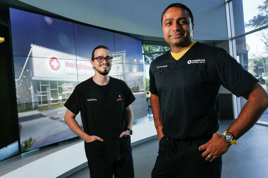 Tom Rivera, left, was promoted from driver to IT worker at Neighbors Emergency Center, which is led by Dr. Setul Patel.  Employees wear scrubs on Fridays so they can stay in touch with the clinical side of the business. Photo: Brett Coomer, Staff / © 2016 Houston Chronicle