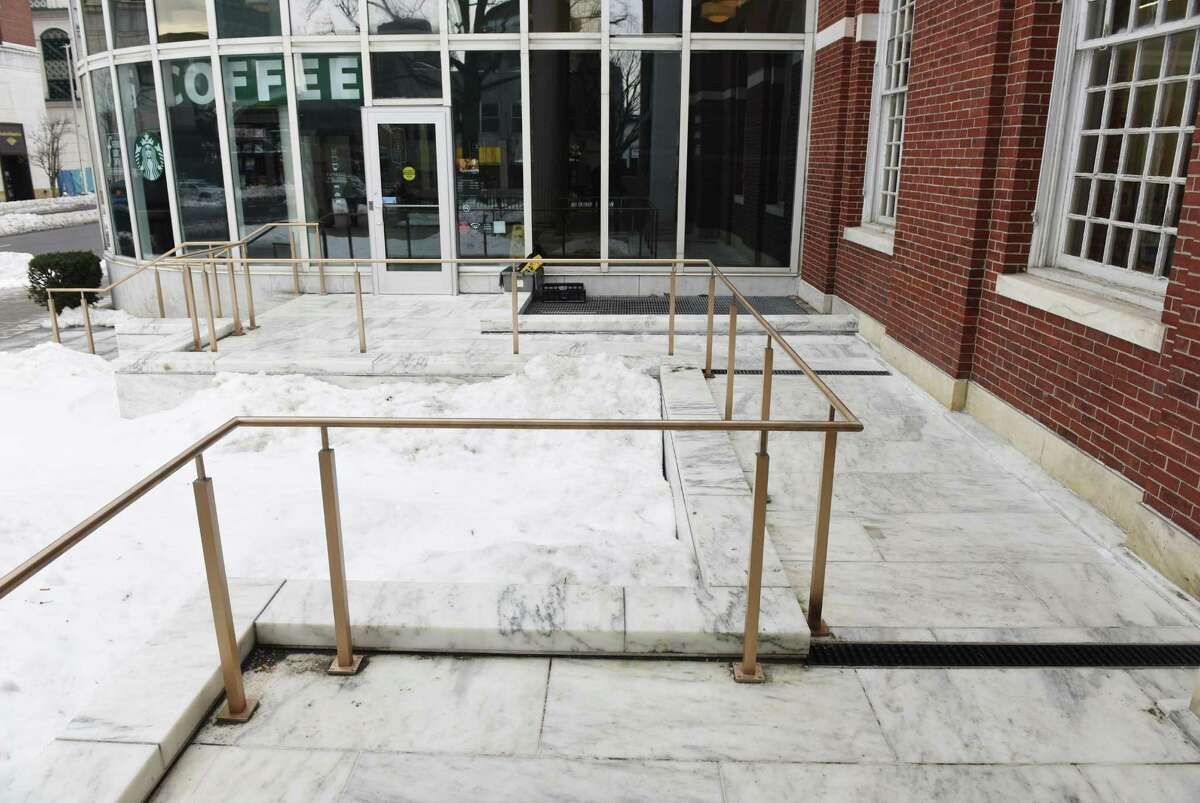 The Ferguson Library in January made a new connection from its ramp to the Starbucks entrance to allow wheelchair access to the cafe even after the library is closed. Stamford's planning to