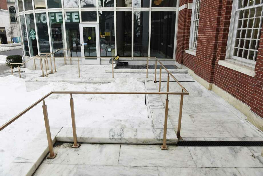 The Ferguson Library in January made a new connection from its ramp to the Starbucks entrance to allow wheelchair access to the cafe even after the library is closed. Stamford's planning to Photo: File Photo / Hearst Connecticut Media / Greenwich Time