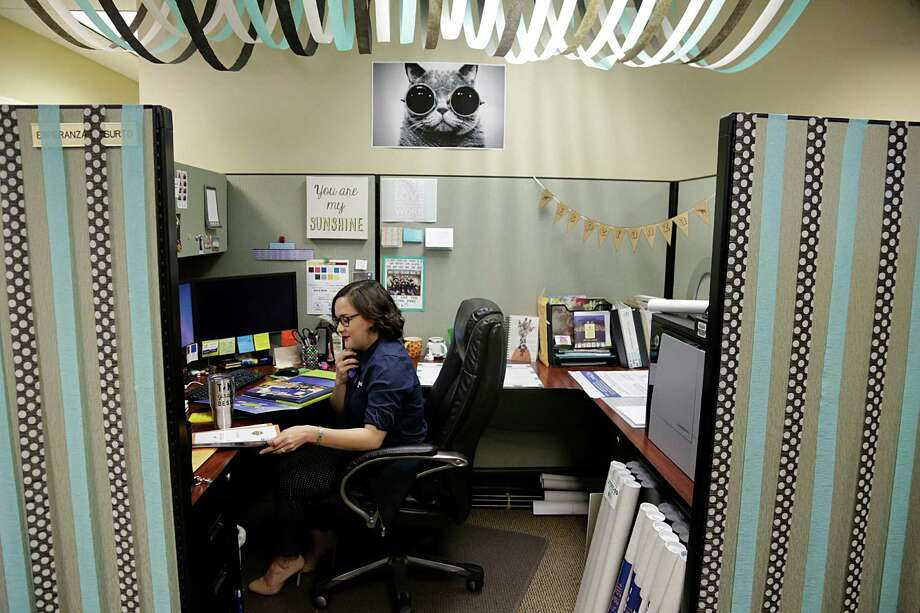 Esperanza Garcia working in the marketing department at the Shell Federal Credit Union main branch Sept. 28, 2016, in Deer Park. ( James Nielsen / Houston Chronicle ) Photo: James Nielsen, Staff / © 2016  Houston Chronicle
