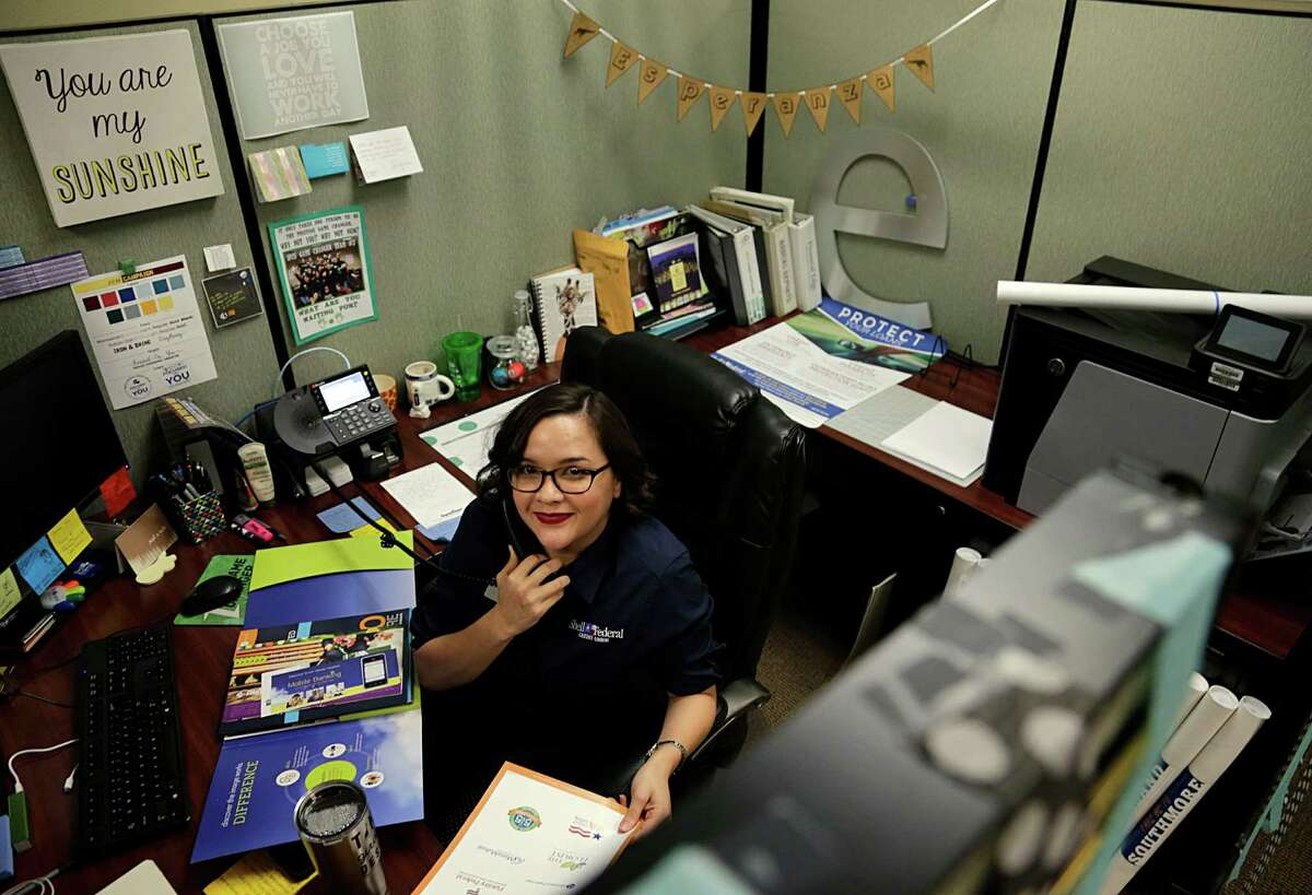 Esperanza Garcia working in the marketing department at the Shell Federal Credit Union main branch Sept. 28, 2016, in Deer Park. ( James Nielsen / Houston Chronicle )