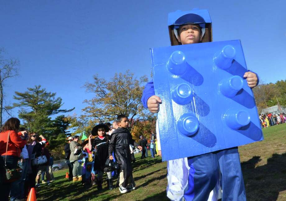 Julez David makes his way with the rest of the school in the parade as Lego Man during the Brookside Elementary School's annual Halloween Parade on Monday October 31, 2016 in Norwalk Conn. Photo: Alex Von Kleydorff / Hearst Connecticut Media / Connecticut Post