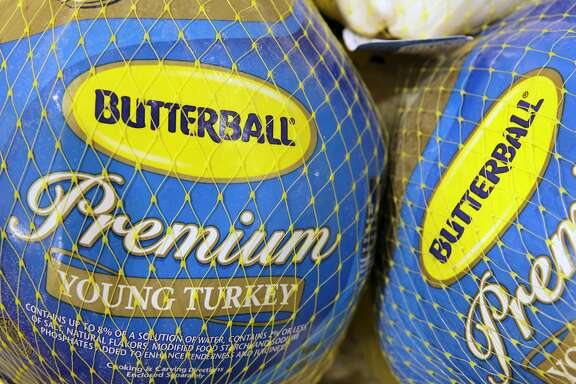 FILE - In this file photo made Dec. 7, 2009, Butterball frozen turkeys are on display at Heinen's grocery store in Bainbridge Township, Ohio. Butterball, which has been fielding phone calls from Thanksgiving cooks for more than 35 years, is letting people text their turkey-related questions this year for the first time. The company�s regular phone help line begins Tuesday, Nov. 1, 2016. Butterball will start take text message questions on Nov. 17, 2016, and continue through Thanksgiving Day. (AP Photo/Amy Sancetta, File)
