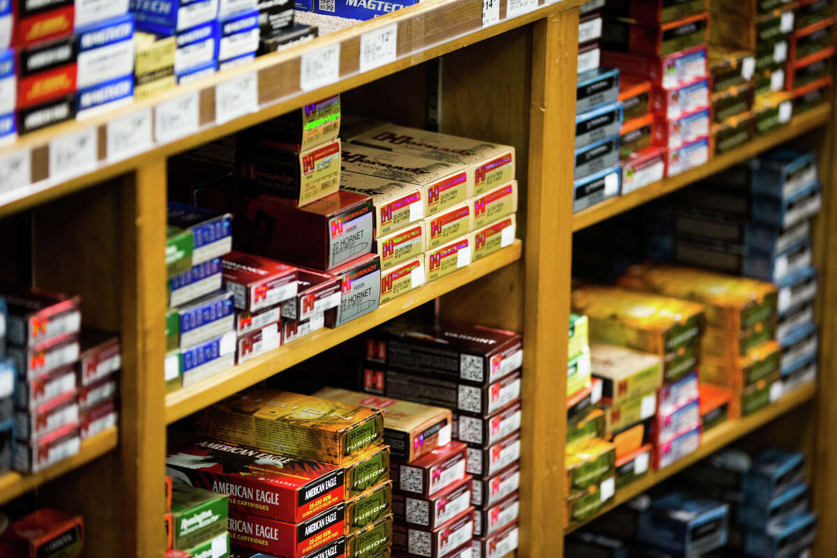 Boxes of ammunition line the shelves behind the counter in the gun room at Outdoor Emporium on Tuesday, Oct. 25, 2016.