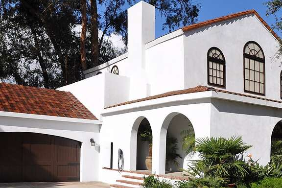SolarCity and Tesla Motors on Friday, Oct. 28 unveiled four styles of solar roofs -- roofs whose tiles contain solar cells.