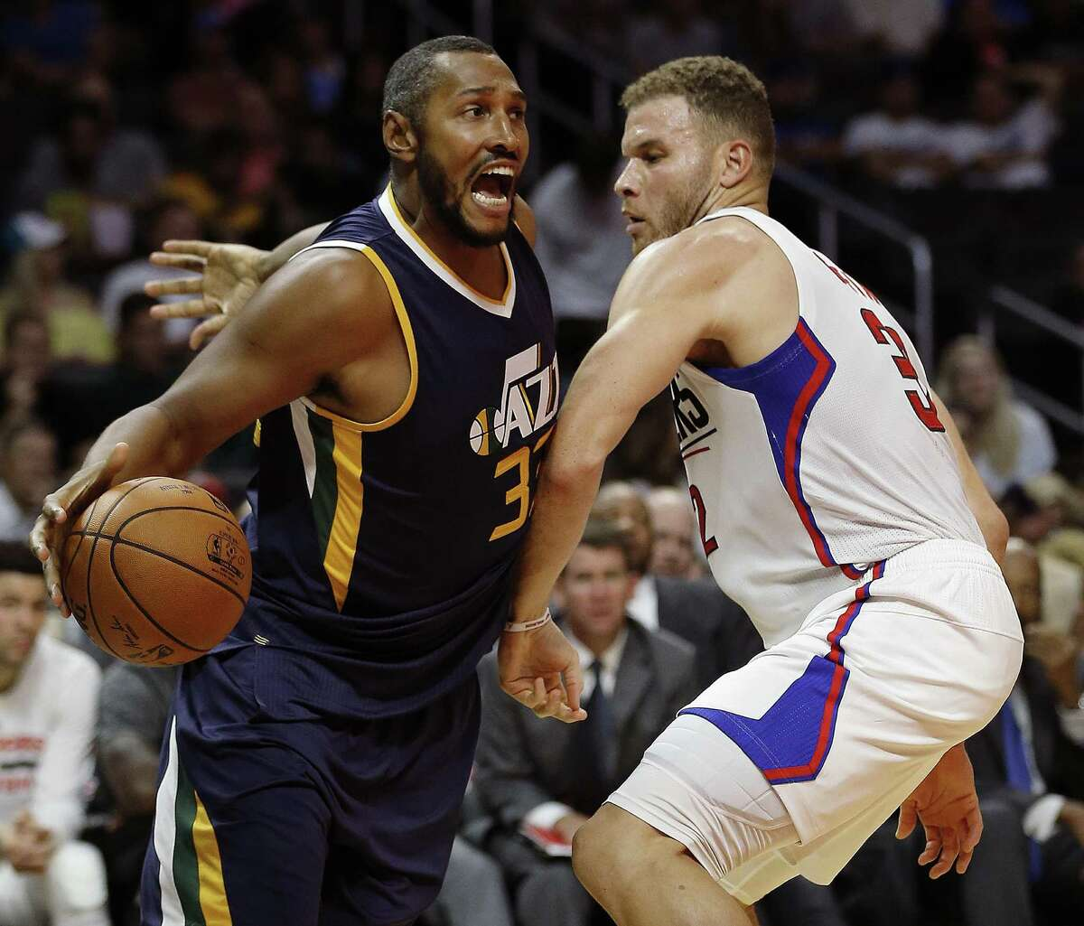 Utah Jazz center Boris Diaw (left) gets fouled driving to the basket against Los Angeles Clippers forward Blake Griffin during a preseason game on Oct. 10, 2016.