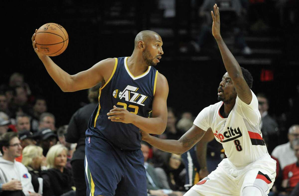 Boris Diaw of the Utah Jazz looks to drive on Al-Farouq Aminu of the Trail Blazers in the first quarter at the Moda Center on Sept. 25, 2016 in Portland.