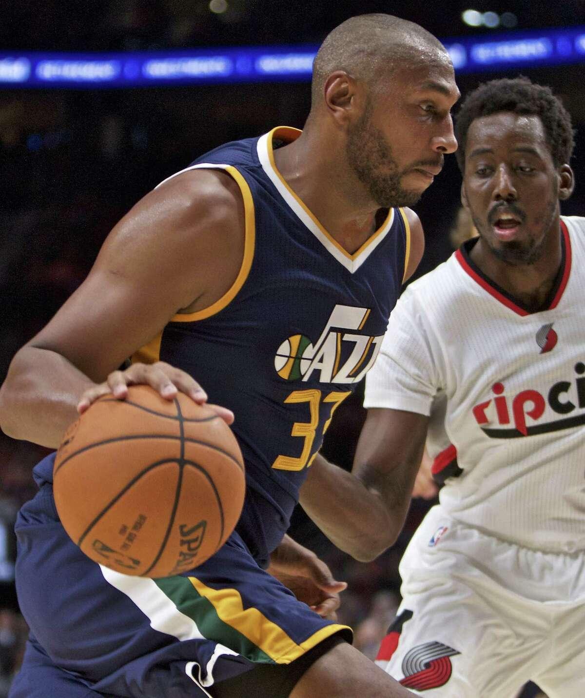 Utah Jazz center Boris Diaw dribbles around Portland Trail Blazers forward Al-Farouq Aminu in the second half on Oct. 25, 2016.