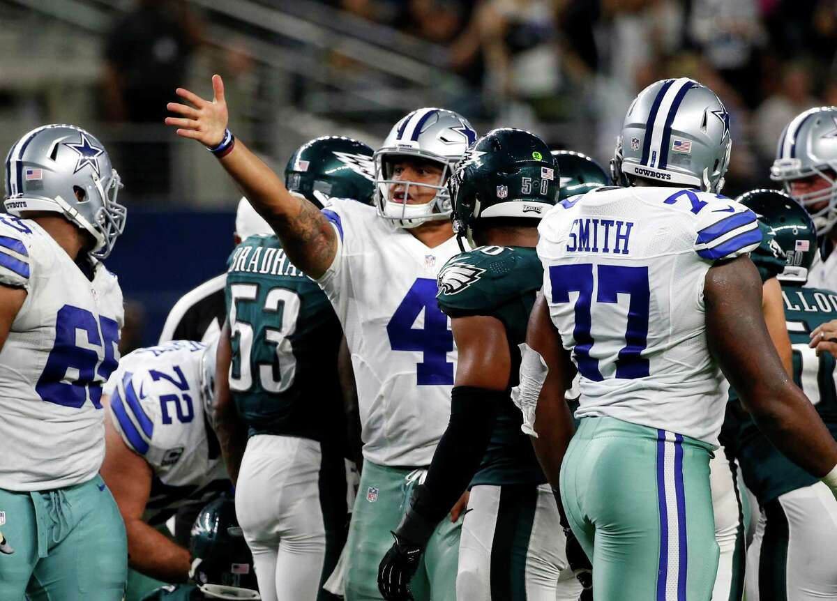 Dallas Cowboys quarterback Dak Prescott (4) signals first down after running the ball against the Philadelphia Eagles in overtime of an NFL football game, Sunday, Oct. 30, 2016, in Arlington, Texas. (AP Photo/Michael Ainsworth)