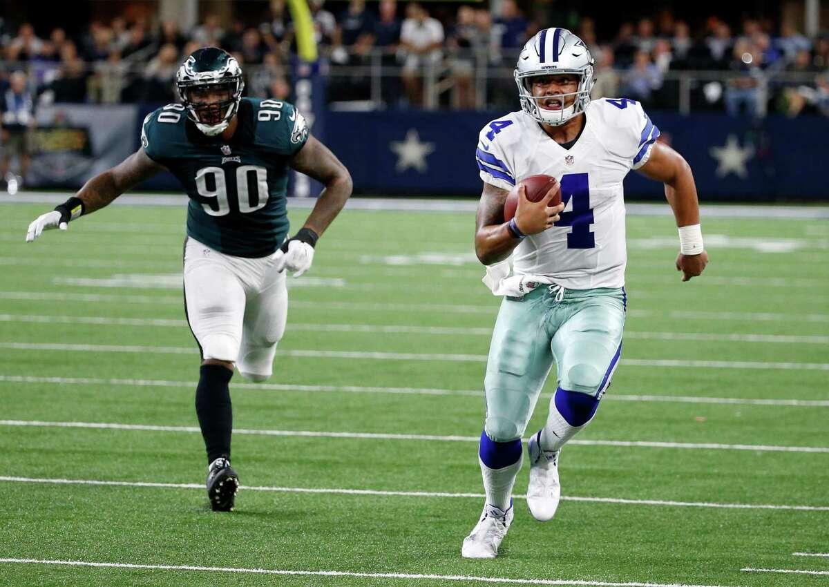 Philadelphia Eagles defensive end Marcus Smith (90) pursues as Dallas Cowboys quarterback Dak Prescott (4) runs the ball for a first down in the second half of an NFL football game, Sunday, Oct. 30, 2016, in Arlington, Texas. (AP Photo/Michael Ainsworth)