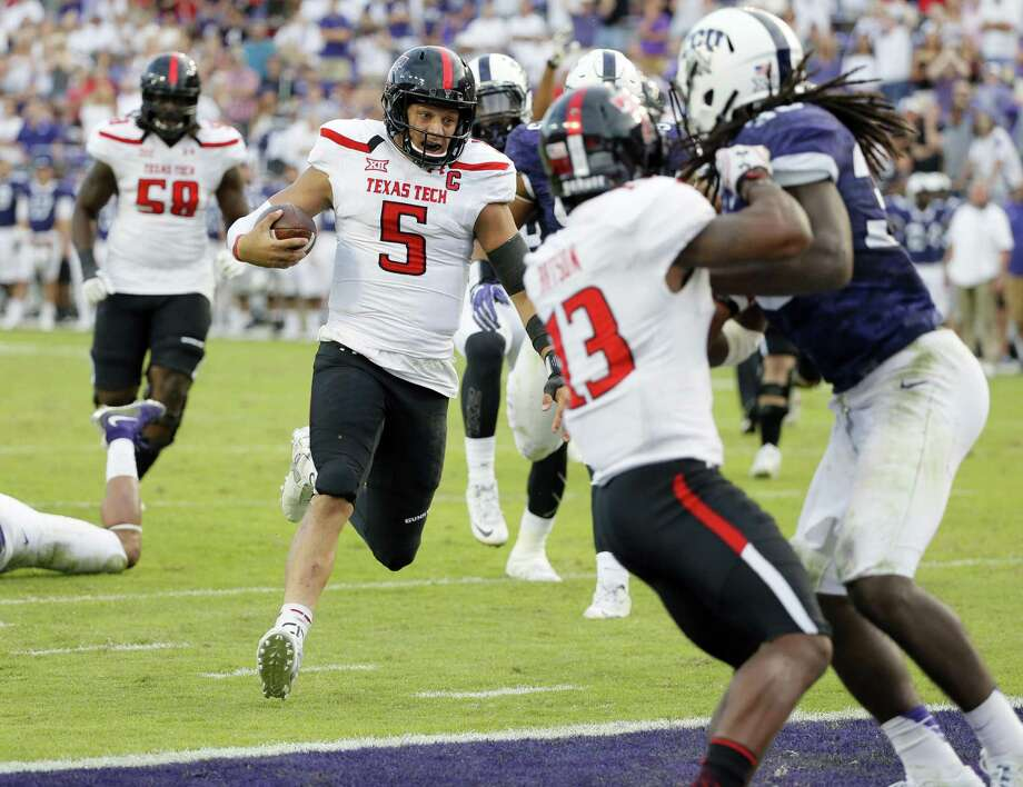 Texas Tech quarterback Patrick Mahomes II scores a touchdown on a running play in overtime against TCU on Oct. 29, 2016, in Fort Worth. Photo: Tony Gutierrez /Associated Press / Copyright 2016 The Associated Press. All rights reserved.