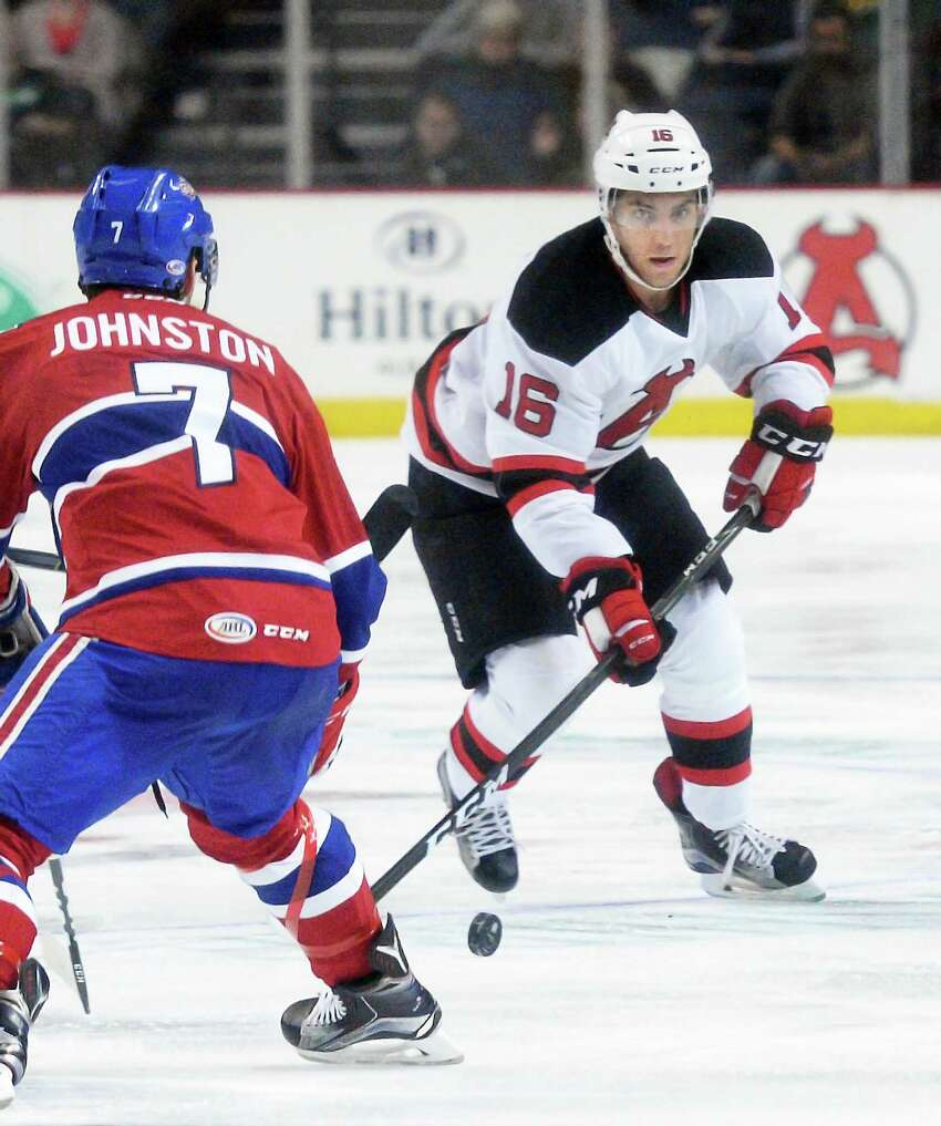 Albany Devils' #16 Ben Sexton works his way past St. John's IceCaps' #7 Ryan Johnston during Saturday's home opener at the Times Union Center Oct. 15, 2016 in Albany, NY. (John Carl D'Annibale / Times Union) ORG XMIT: MER2016101520303044