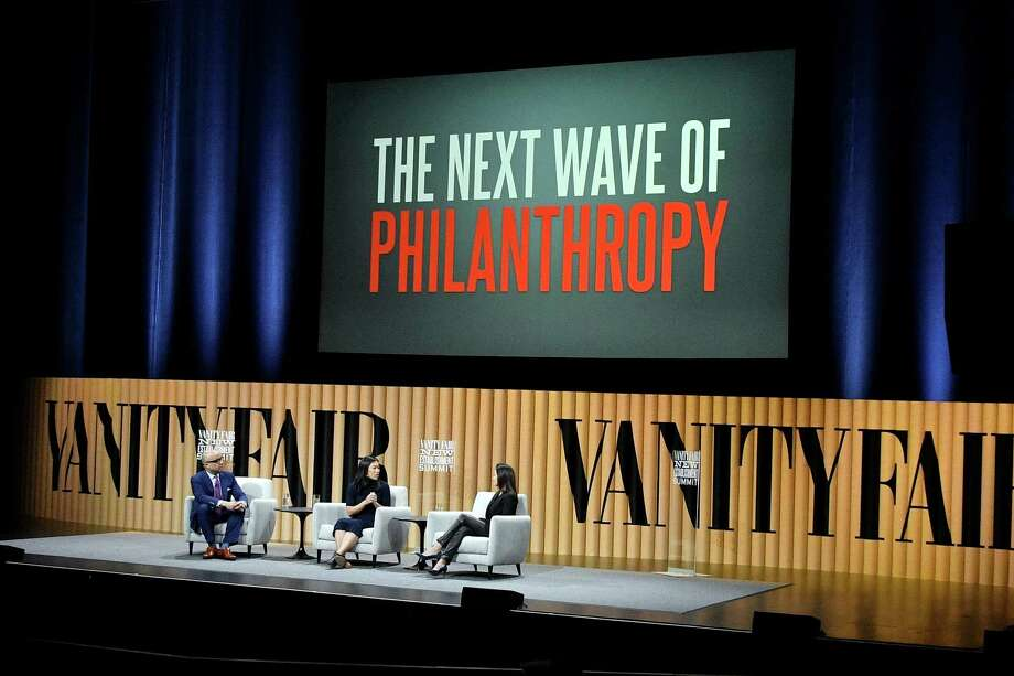 "(L-R) President of the Ford Foundation, Darren Walker, co-founder of the Chan Zuckerberg Initiative, Priscilla Chan, and president of the Goldman Sachs Foundation, Dina Powell, speak onstage during ""The Next Wave of Philanthropy"" at the Vanity Fair New Establishment Summit at Yerba Buena Center for the Arts on Oct. 20 in San Francisco, Calif. Nationally, as locally, philathropy can help to fill in gaps created by inadequate government spending on goods and services. But it can't replace sound public policy. Photo: Mike Windle, Staff / 2016 Getty Images"