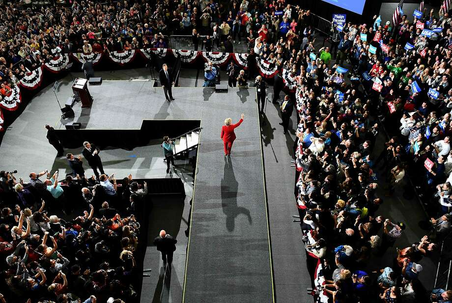 Democratic presidential candidate Hillary Clinton, who has pledged to stay on course during the FBI investigation, greets supporters during a rally at Kent State University in Ohio. Photo: JEWEL SAMAD, AFP/Getty Images