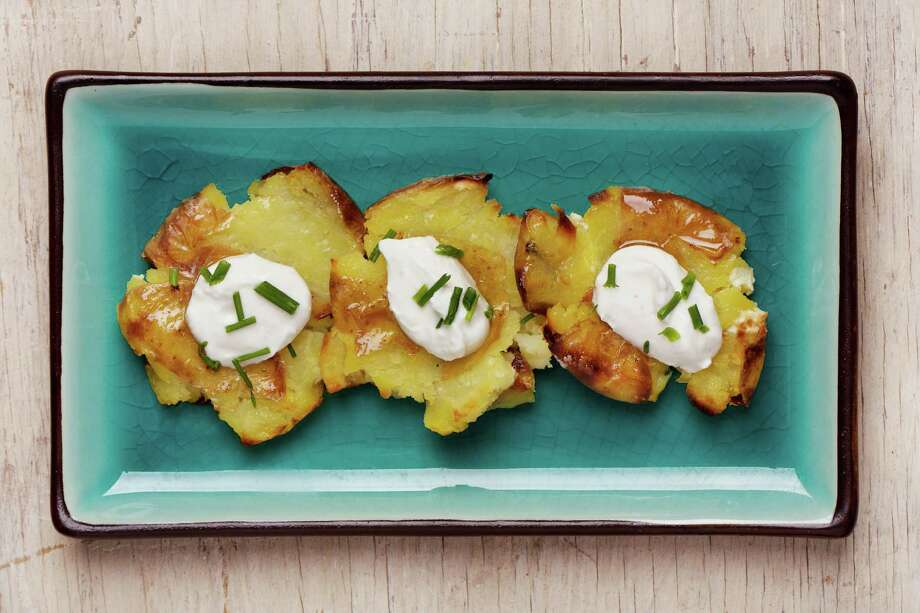 Crushed Potatoes are a fun and easy alternative to mashed potatoes. Photo: Deb Lindsey / For The Washington Post
