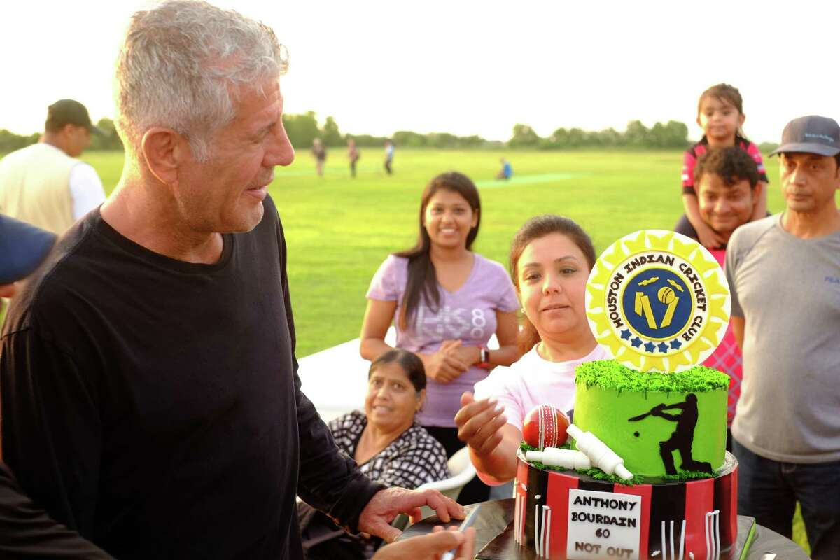 Anthony Bourdain attends a tandoori cookout in Richmond during the