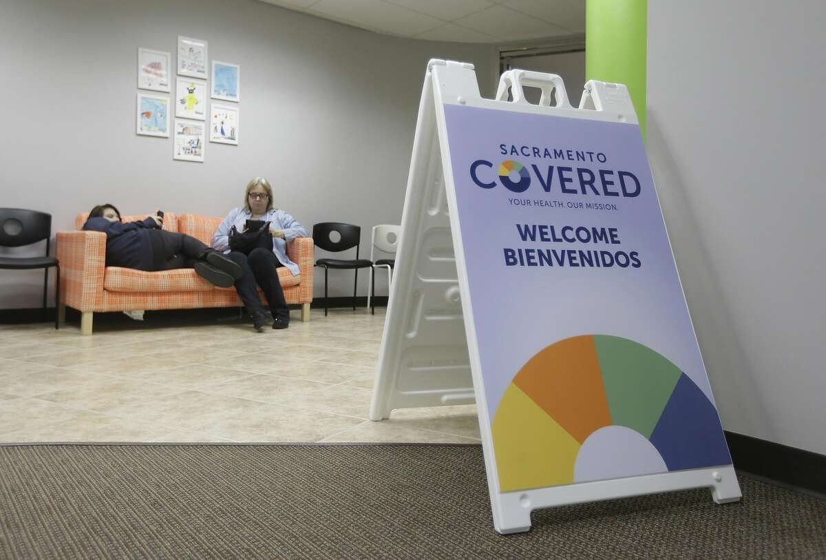 Laura San Nicolas, right, and her daughter Geena, 17,wait to meet with an enrollment counselor to sign up for health insurance at Sacramento Covered in Sacramento, Calif., Thursday, Feb. 12, 2015. Peter Lee, executive director of Covered California, announced, Thursday, Feb. 4, 2016, that more than 425,000 people signed up for private health insurance coverage during the third enrollment period under President Barack Obama's health care law.(AP Photo/Rich Pedroncelli, file)