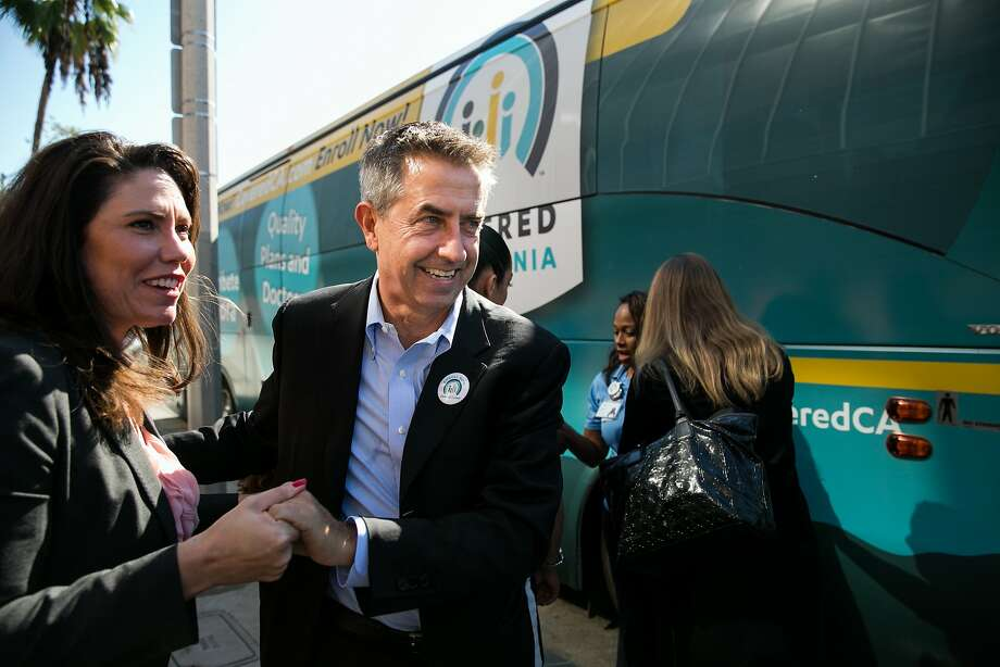 Under Covered California Executive Director Peter Lee (center), shown greeting supporters in 2015, 1.4 million residents have purchased insurance through the state's health exchange marketplace, a key component of President Obama's law. Photo: Marcus Yam, LA Times Via Getty Images