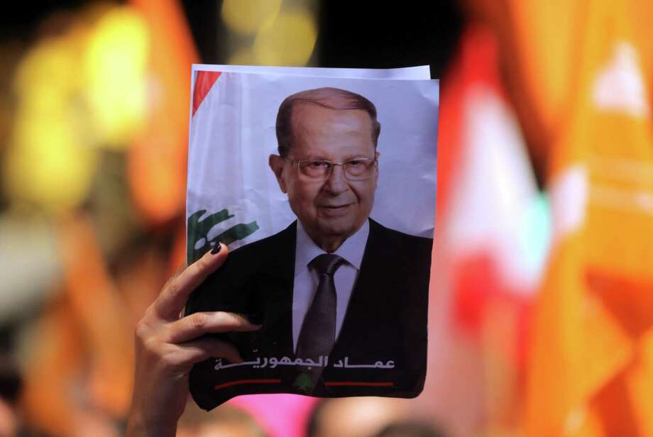 Lebanese celebrate the election for president of Michel Aoun (seen in portrait), a former general backed by the powerful Hezbollah movement. Photo: STRINGER, Stringer / AFP or licensors