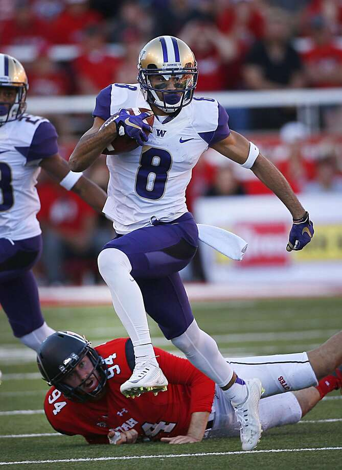 Dante Pettis returns a punt 58 yards for a touchdown late in the fourth quarter to give Washington a 31-24 win at Utah. Photo: George Frey, Getty Images