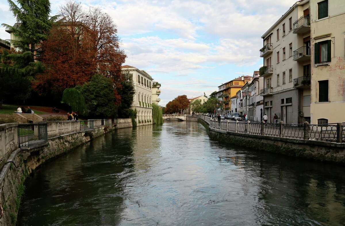 This Sept. 20, 2016 photo shows Treviso in Northern Italy. With two rivers and numerous canals, Treviso is a good place for a stroll. The city is about an hour's drive from Venice and is in the heart of prosecco country. (Michelle Locke via AP)
