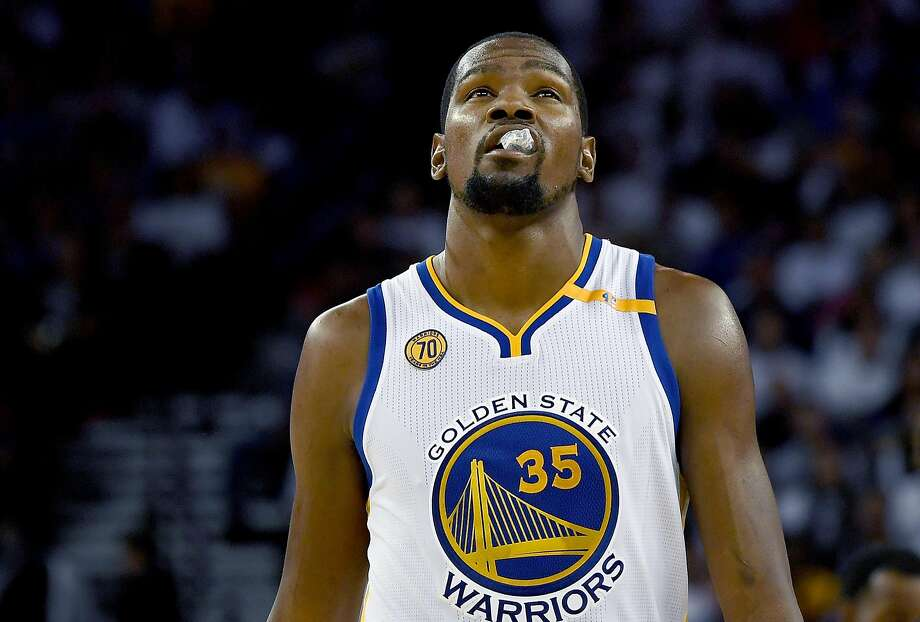 OAKLAND, CA - OCTOBER 25:  Kevin Durant #35 of the Golden State Warriors looks on against the San Antonio Spurs during the third quarter in an NBA basketball game at ORACLE Arena on October 25, 2016 Oakland, California. NOTE TO USER: User expressly acknowledges and agrees that, by downloading and or using this photograph, User is consenting to the terms and conditions of the Getty Images License Agreement.  (Photo by Thearon W. Henderson/Getty Images) Photo: Thearon W. Henderson, Getty Images