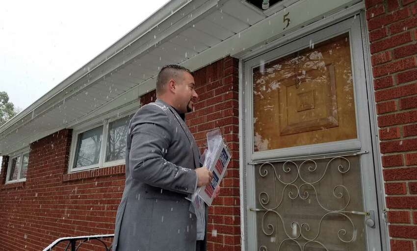 Christopher Davis, a Republican running against incumbent Neil Breslin in the 44th Senate District, campaigned door to door in Colonie on Oct. 27, 2016. Davis estimates he has knocked on more than 10,000 doors in the district. (Chris Churchill/ Times Union)