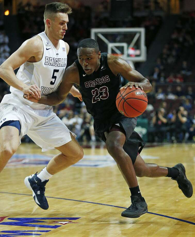 Santa Clara guard Jared Brownridge (23) drives into BYU guard Kyle Collinsworth (5) during the second half of a West Coast Conference tournament NCAA college basketball game Saturday, March 5, 2016, in Las Vegas. (AP Photo/John Locher) Photo: John Locher, AP
