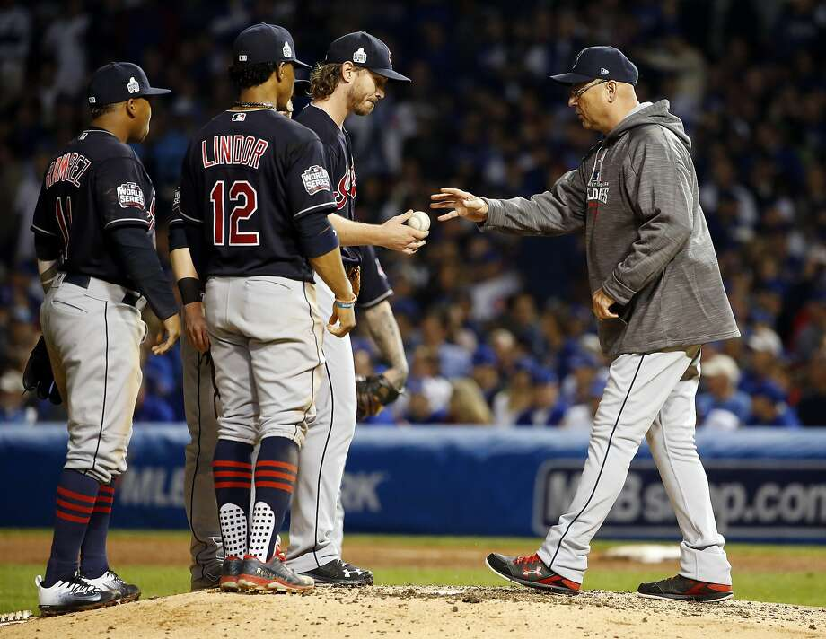 Indians manager Terry Francona takes the ball from starting pitcher Josh Tomlin during the fifth inning of Game 3 of the World Series. Tomlin threw just 58 pitches in his 4 2/3  innings. Photo: Nam Y. Huh, Associated Press