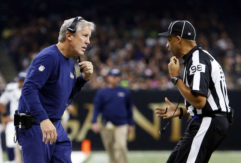 Seattle Seahawks head coach Pete Carroll talks to an official in the first half of an NFL football game against the New Orleans Saints in New Orleans, Sunday, Oct. 30, 2016. (AP Photo/Butch Dill) Photo: Butch Dill/AP