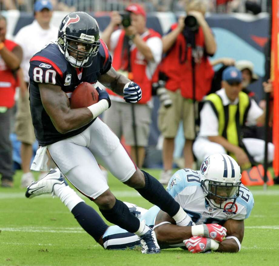 Houston Texans wide receiver Andre Johnson (80) makes a catch in front of Tennessee Titans cornerback Nick Harper (20) during the first quarter of an NFL football game at LP Field Sunday, Sept. 20, 2009, in Nashville. The Texans beat the Titans 34-31. ( Brett Coomer / Chronicle ) Photo: Brett Coomer, Staff / © 2009 Houston Chronicle