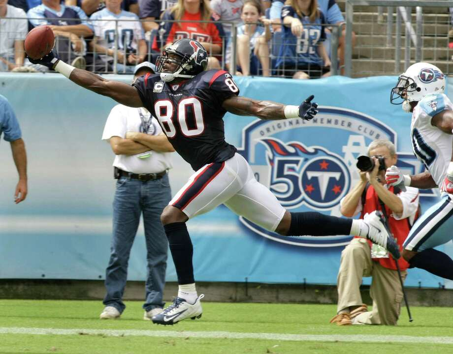 Houston Texans wide receiver Andre Johnson reaches out to grab a 19-yard touchdown reception against the Tennessee Titans during the first quarter of an NFL football game at LP Field Sunday, Sept. 20, 2009, in Nashville. ( Brett Coomer / Chronicle ) Photo: Brett Coomer, Staff / © 2009 Houston Chronicle