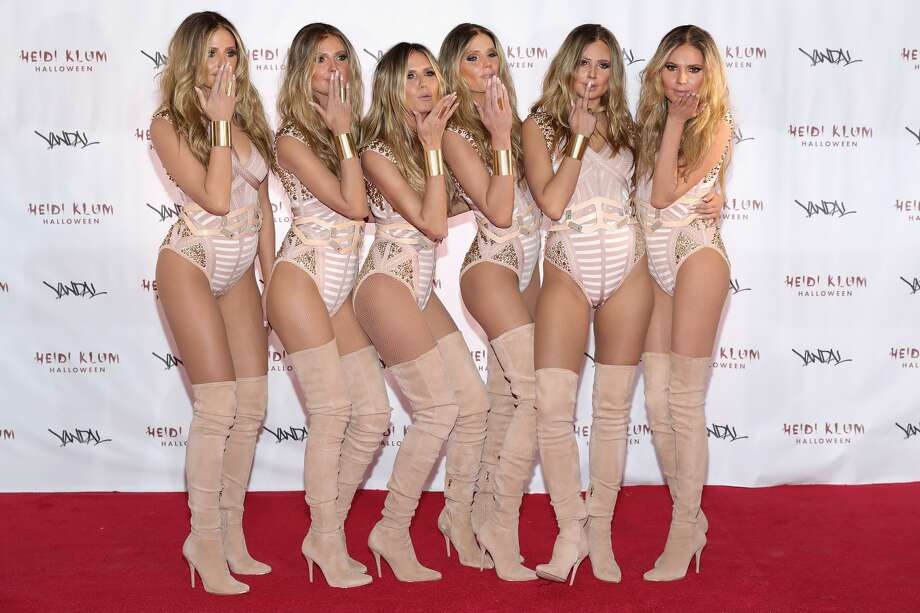 With the help of five lookalikes, supermodel Heidi Klum, third from left, unveiled her Halloween costume in New York on Monday. Photo: Neilson Barnard, Getty Images For Heidi Klum