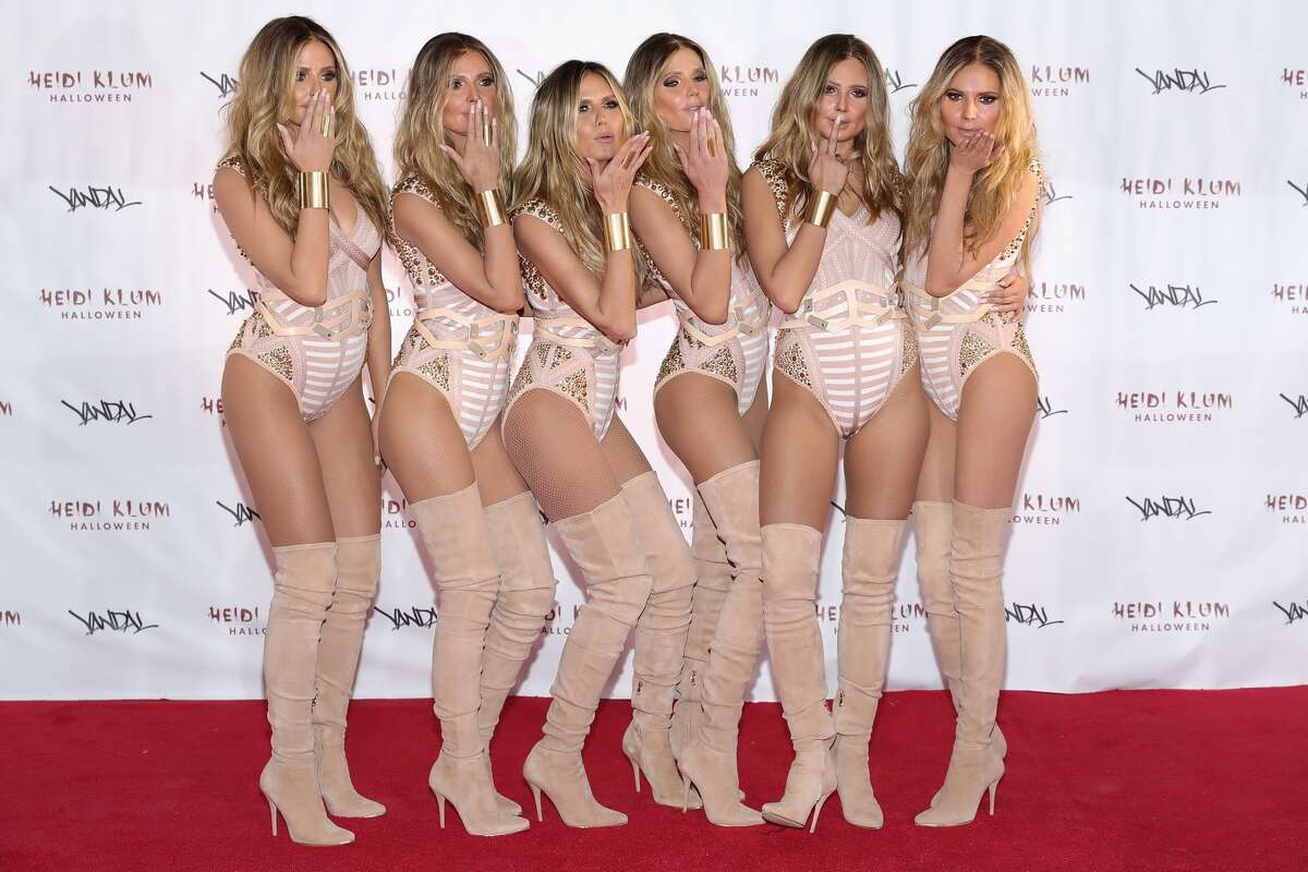 With the help of lookalikes, supermodel Heidi Klum, third from left, unveiled her Halloween costume in New York on Monday.